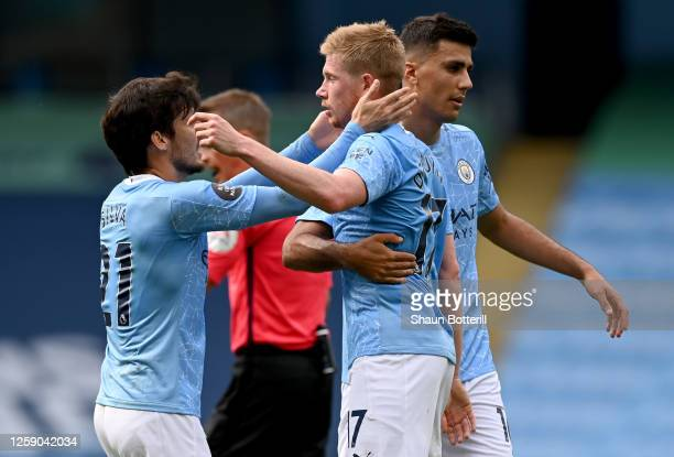 Kevin De Bruyne of Manchester City and teammate David Silva celebrate after scoring his sides second goal during the Premier League match between...