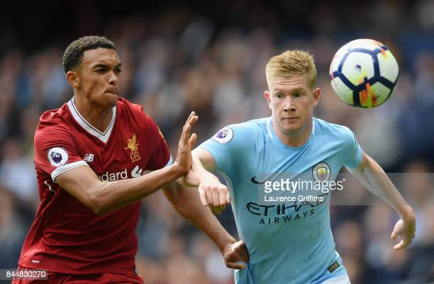Kevin De Bruyne of Manchester City and Trent Alex Arnold of Liverpool battle for possession during the Premier League match between Manchester City...