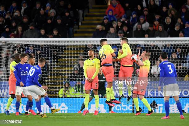 Kevin De Bruyne of Manchester City attempts to block the free kick taken by James Maddison of Leicester City during the Premier League match between...
