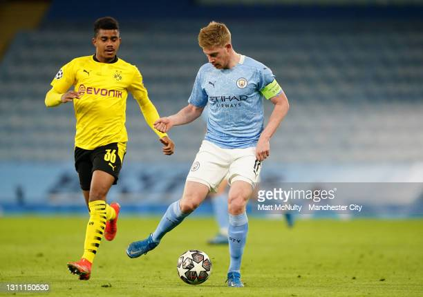 Kevin De Bruyne of Manchester City battles for possession with Ansgar Knauff of Borussia Dortmund during the UEFA Champions League Quarter Final...