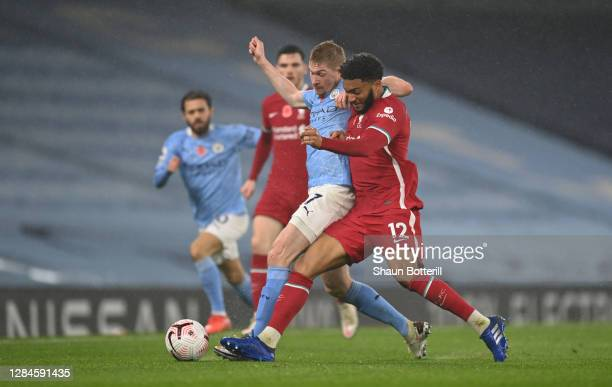 Kevin De Bruyne of Manchester City battles for possession with Joe Gomez of Liverpool during the Premier League match between Manchester City and...