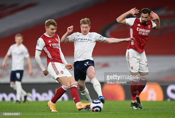 Kevin De Bruyne of Manchester City battles for possession with Martin Odegaard of Arsenal during the Premier League match between Arsenal and...