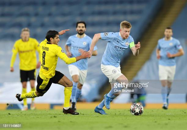Kevin De Bruyne of Manchester City battles for possession with Mahmoud Dahoud of Borussia Dortmund during the UEFA Champions League Quarter Final...