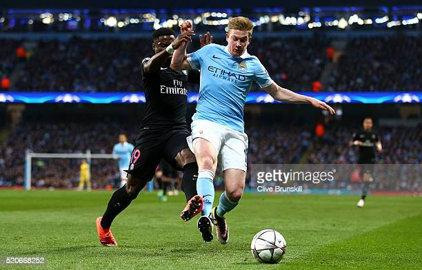 Kevin de Bruyne of Manchester City battles with Serge Aurier of Paris SaintGermain during the UEFA Champions League quarter final second leg match...
