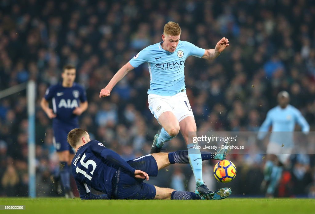 Kevin De Bruyne of Manchester City beats Eric Dier of Tottenham Hotspur during the Premier League match between Manchester City and Tottenham Hotspur at Etihad Stadium on December 16, 2017 in Manchester, England.
