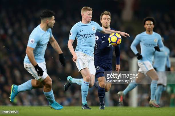 Kevin De Bruyne of Manchester City brings down the ball while under pressure from Christian Eriksen during the Premier League match between...