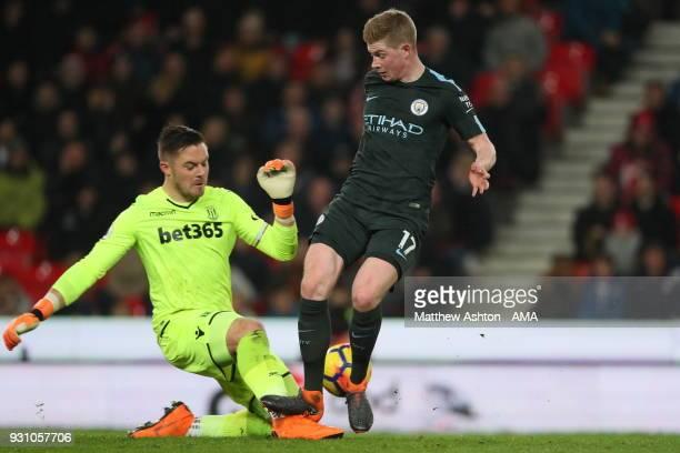 Kevin De Bruyne of Manchester City catches the ankle of Jack Butland of Stoke City during the Premier League match between Stoke City and Manchester...