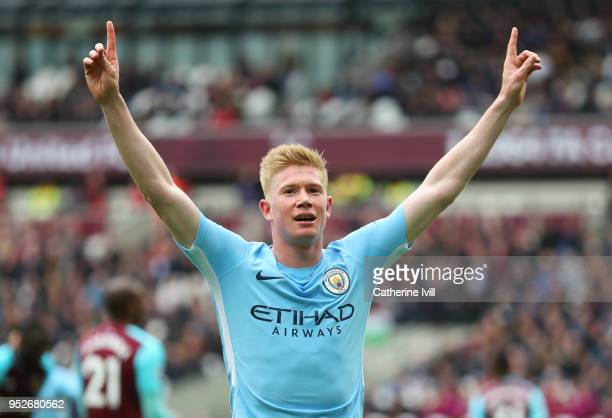 Kevin De Bruyne of Manchester City celebrates after his cross was deflected into the net by Declan Rice of West Ham United for a own goal and...