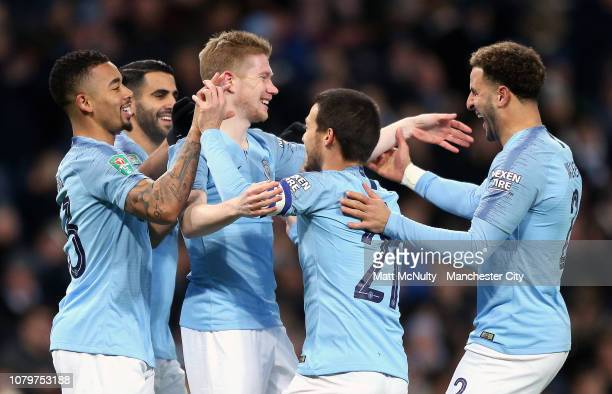 Kevin De Bruyne of Manchester City celebrates after scoring his team's first goal with team mates during the Carabao Cup Semi Final First Leg match...