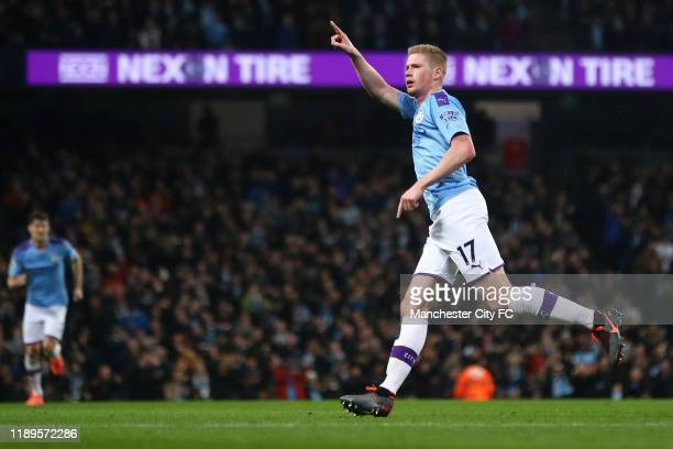 Kevin De Bruyne of Manchester City celebrates after scoring his team's second goal as Mateo Kovacic of Chelsea reacts during the Premier League match...