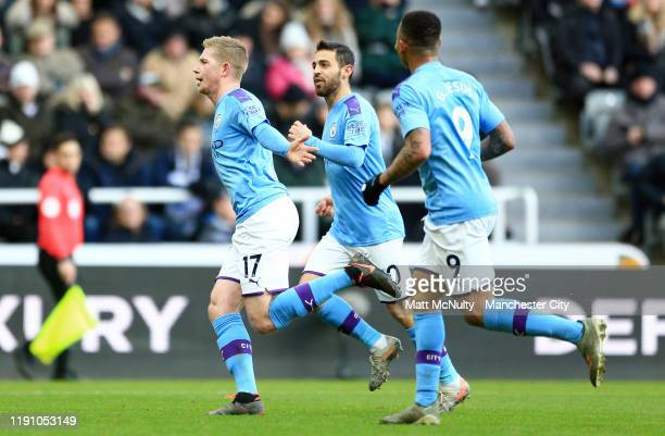 Kevin De Bruyne of Manchester City celebrates after scoring his team's second goal with Bernardo Silva and Gabriel Jesus during the Premier League...