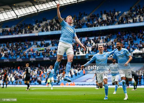 Kevin de Bruyne of Manchester City celebrates after scoring his teams first goal during the Premier League match between Manchester City and Everton...