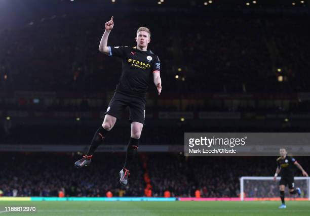 Kevin de Bruyne of Manchester City celebrates after scoring the opening goal during the Premier League match between Arsenal FC and Manchester City...