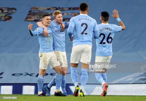 Kevin De Bruyne of Manchester City celebrates after scoring their team's fifth goal with team mates Phil Foden and Riyad Mahrez during the Premier...