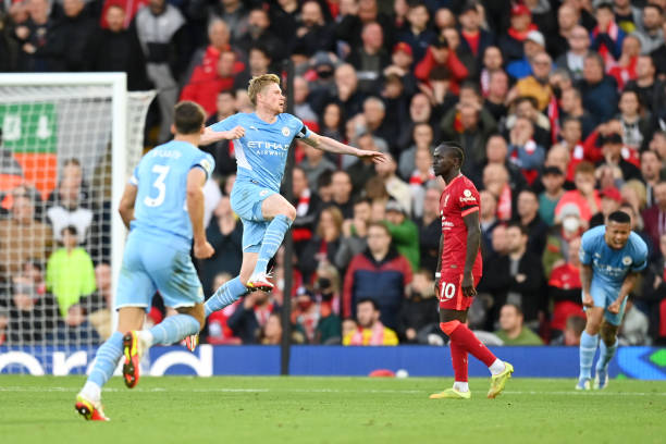 Kevin De Bruyne of Manchester City celebrates after scoring their side's second goal during the Premier League match between Liverpool and Manchester...