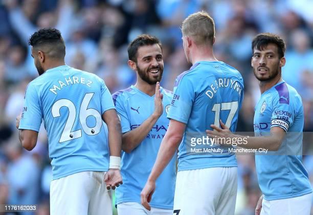 Kevin De Bruyne of Manchester City celebrates as he scores his team's eighth goal with Bernardo Silva, David Silva and Riyad Mahrez of Manchester...