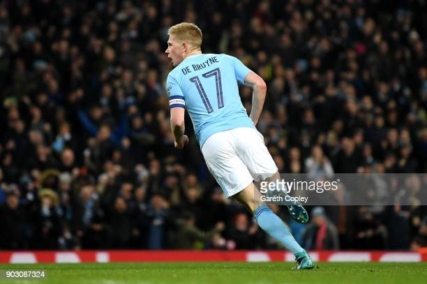 Kevin De Bruyne of Manchester City celebrates as he scores their first goal during the Carabao Cup SemiFinal First Leg match between Manchester City...