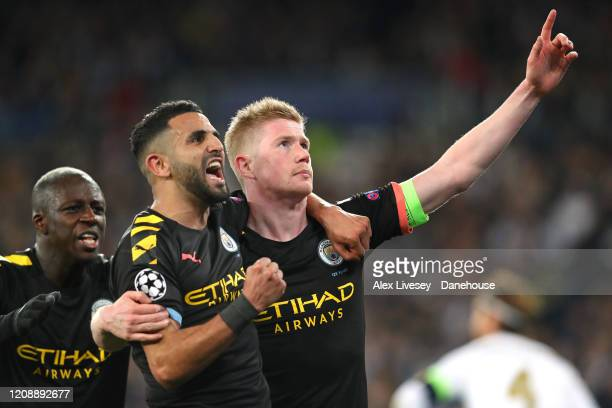Kevin De Bruyne of Manchester City celebrates his goal with Riyad Mahrez during the UEFA Champions League round of 16 first leg match between Real...