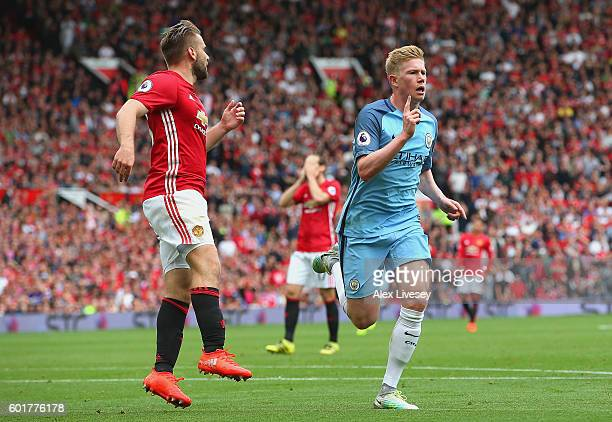 Kevin De Bruyne of Manchester City celebrates scoring his sides first goal during the Premier League match between Manchester United and Manchester...