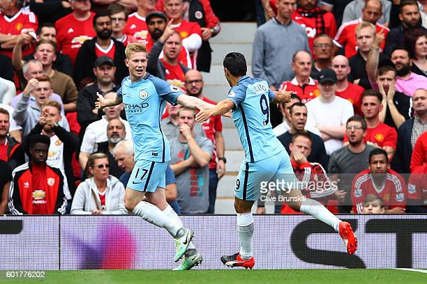 Kevin De Bruyne of Manchester City celebrates scoring his sides first goal with Nolito of Manchester City during the Premier League match between...