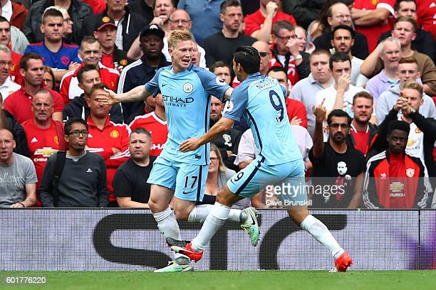Kevin De Bruyne of Manchester City celebrates scoring his sides first goal with his team mate Nolito of Manchester City during the Premier League...