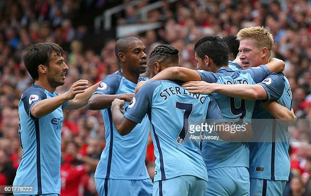 Kevin De Bruyne of Manchester City celebrates scoring his sides first goal with his team mates during the Premier League match between Manchester...