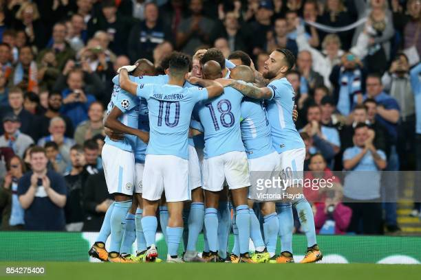 Kevin De Bruyne of Manchester City celebrates scoring his sides first goal with his Manchester City team mates during the UEFA Champions League Group...