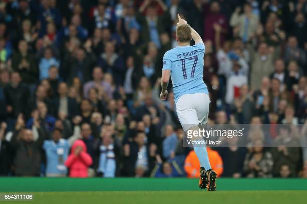 Kevin De Bruyne of Manchester City celebrates scoring his sides first goal during the UEFA Champions League Group F match between Manchester City and...