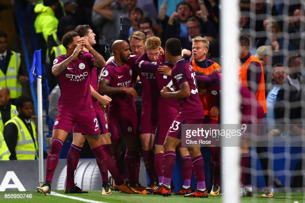 Kevin De Bruyne of Manchester City celebrates scoring his sides first goal with his Manchester City team mates during the Premier League match...