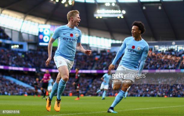Kevin De Bruyne of Manchester City celebrates scoring his sides first goal with Leroy Sane of Manchester City during the Premier League match between...