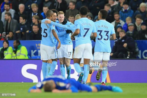 Kevin De Bruyne of Manchester City celebrates scoring his side's second goal with his team mates during the Premier League match between Leicester...
