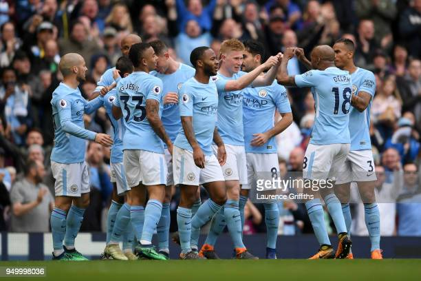 Kevin De Bruyne of Manchester City celebrates scoring his side's third goal with team mates during the Premier League match between Manchester City...