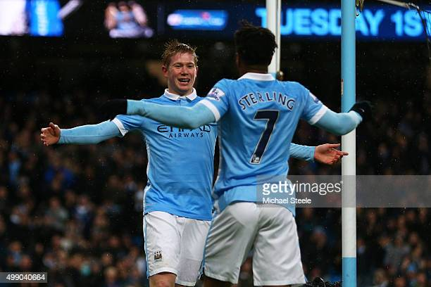 Kevin de Bruyne of Manchester City celebrates scoring his team's first goal with his team mate Raheem Sterling during the Barclays Premier League...