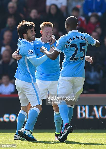 Kevin de Bruyne of Manchester City celebrates scoring his team's second goal with his team mates David Silva and Fernandinho during the Barclays...