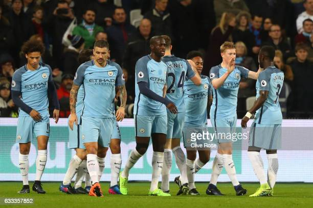 Kevin De Bruyne of Manchester City celebrates scoring the opening goal with team mates during the Premier League match between West Ham United and...