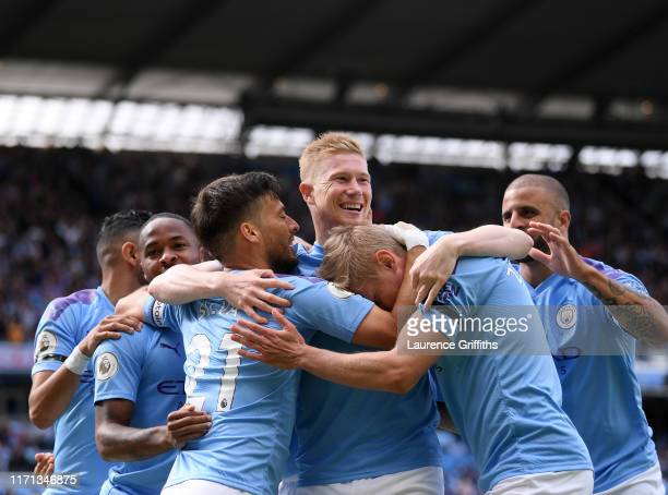 Kevin De Bruyne of Manchester City celebrates the first goal with teammate s and Oleksandr Zinchenko during the Premier League match between...