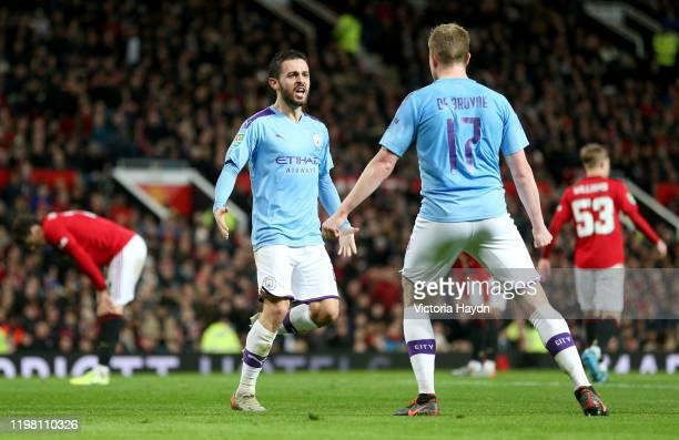 Kevin De Bruyne of Manchester City celebrates with Bernardo Silva after scoring his team's third goal during the Carabao Cup Semi Final match between...
