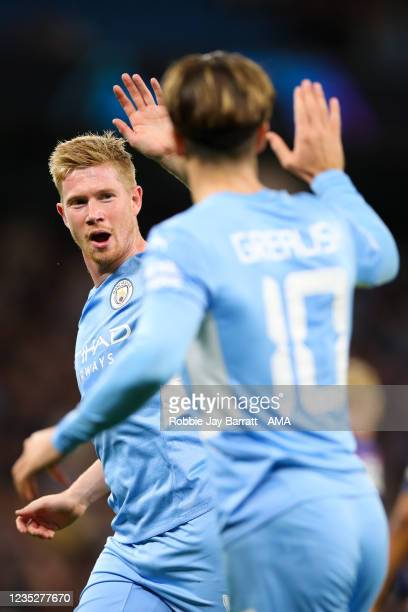 Kevin De Bruyne of Manchester City celebrates with Jack Grealish of Manchester City during the UEFA Champions League group A match between Manchester...