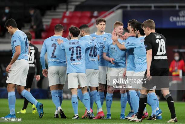 Kevin De Bruyne of Manchester City celebrates with John Stones and team mates after scoring their side's first goal during the UEFA Champions League...