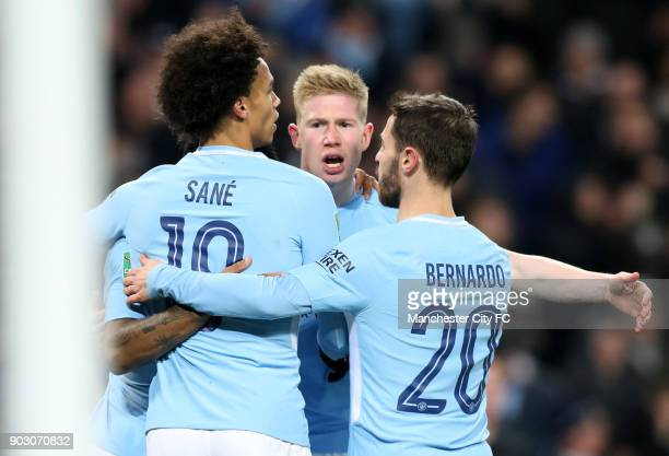 Kevin De Bruyne of Manchester City celebrates with Leroy Sane and Bernardo Silva as he scores their first goal during the Carabao Cup SemiFinal First...