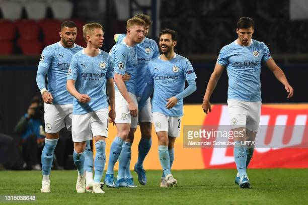 Kevin De Bruyne of Manchester City celebrates with Oleksandr Zinchenko, John Stones and Bernardo Silva after scoring their side's first goal during...