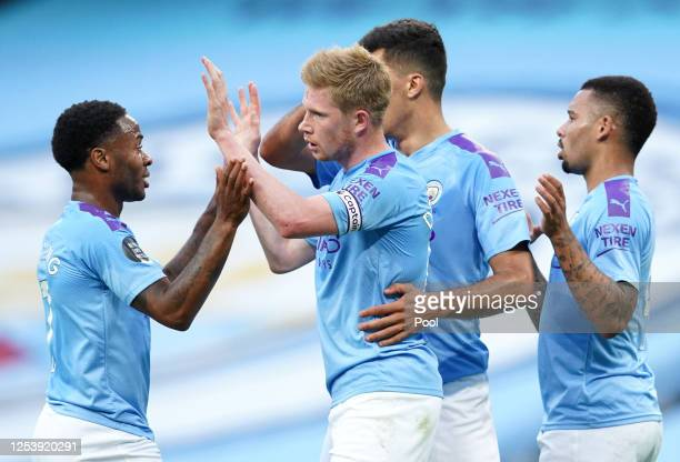 Kevin De Bruyne of Manchester City celebrates with Raheem Sterling and Gabriel Jesus after scoring his team's first goal during the Premier League...
