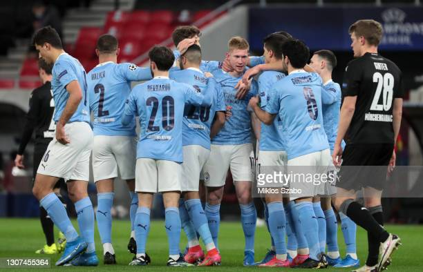 Kevin De Bruyne of Manchester City celebrates with team mates after scoring their side's first goal during the UEFA Champions League Round of 16...