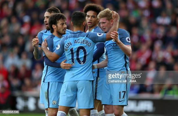 Kevin De Bruyne of Manchester City celebrates with team mates David Silva Sergio Aguero and Leroy Sane of Manchester City during the Premier League...