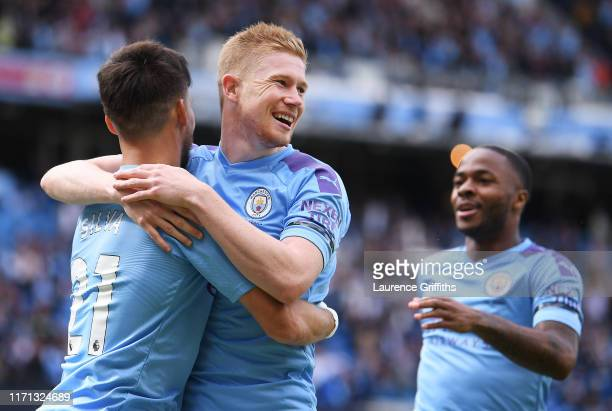 Kevin De Bruyne of Manchester City celebrates with teammate David Silva of Manchester City after scoring his team's first goal during the Premier...