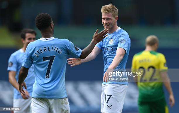 Kevin De Bruyne of Manchester City celebrates with teammate Raheem Sterling after scoring his sides second goal during the Premier League match...