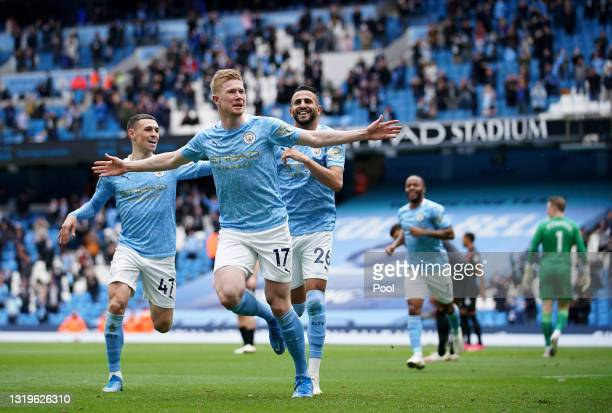 Kevin De Bruyne of Manchester City celebrates with teammate Riyad Mahrez after scoring his team's first goal during the Premier League match between...