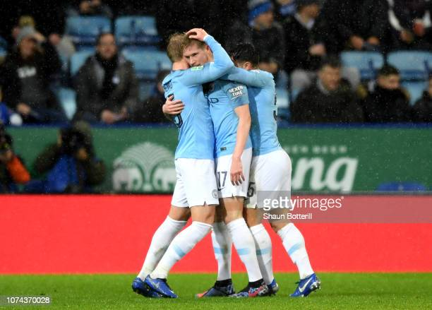 Kevin De Bruyne of Manchester City celebrates with teammates after scoring his team's first goal during the Carabao Cup Quarter Final match between...