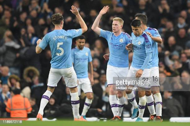 Kevin De Bruyne of Manchester City celebrates with teammates after scoring his team's second goal as ch during the Premier League match between...