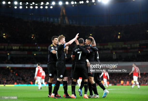 Kevin De Bruyne of Manchester City celebrates with teammates after scoring his team's first goal during the Premier League match between Arsenal FC...